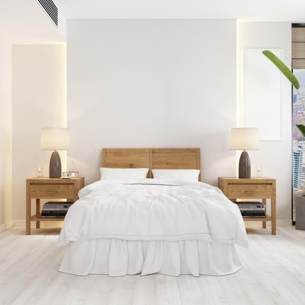 cabeceira em madeira na cama posta