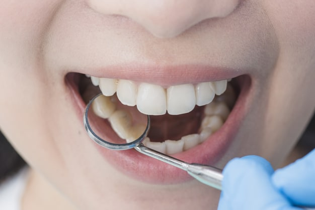 saúde bucal mulher no dentista
