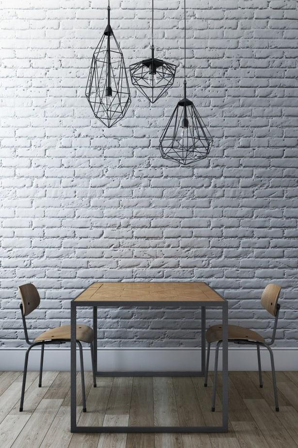 pendentes na sala de jantar em tamanhos diferentes